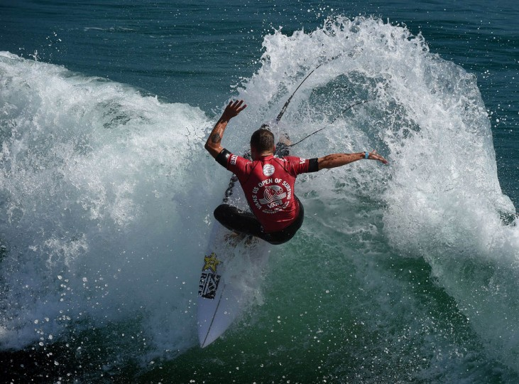 Professional surfer Mitch Crews of Australia does a cutback as he competes during his round two men's heat of the US Open of Surfing in Huntington Beach, California on July 29, 2015. The event celebrates it's 56th year beside the historic Huntington Pier which is considered the birthplace of California's surfing culture. (Mark Ralston/Getty Images)