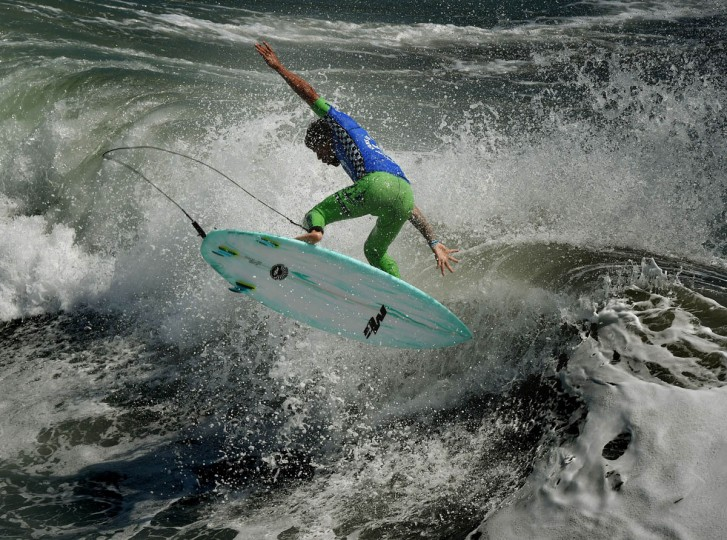 Professional surfer Heitor Alves of Brazil gets some air as he competes during his round two men's heat of the US Open of Surfing in Huntington Beach, California on July 29, 2015. The event celebrates it's 56th year beside the historic Huntington Pier which is considered the birthplace of California's surfing culture. (Mark Ralston/Getty Images)