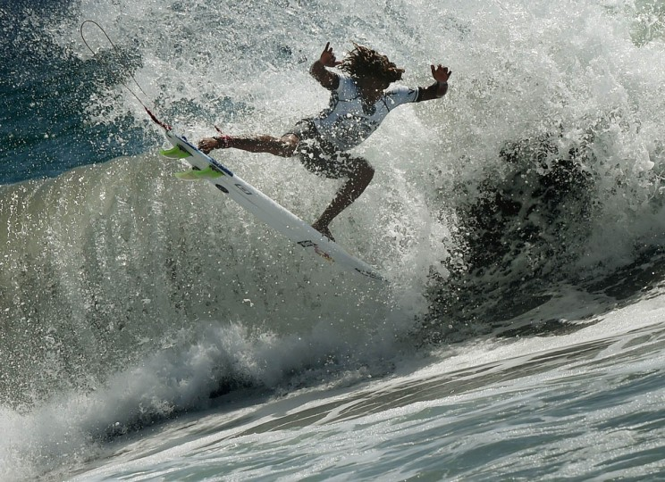 Professional surfer Carlos Munoz of Costa Rica gets some air as he competes during his round two men's heat of the US Open of Surfing in Huntington Beach, California on July 29, 2015. The event celebrates it's 56th year beside the historic Huntington Pier which is considered the birthplace of California's surfing culture. (Mark Ralston/Getty Images)