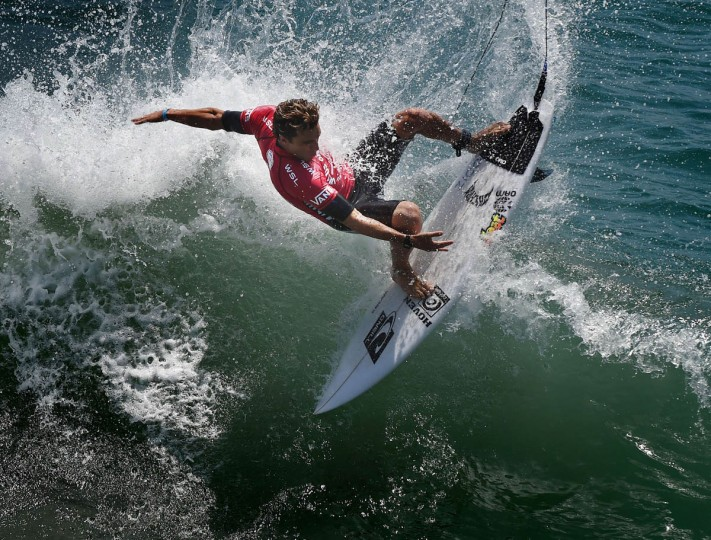 Professional surfer Nathan Yeomans of the US competes during his round two men's heat of the US Open of Surfing in Huntington Beach, California on July 29, 2015. The event celebrates it's 56th year beside the historic Huntington Pier which is considered the birthplace of California's surfing culture. (Mark Ralston/Getty Images)