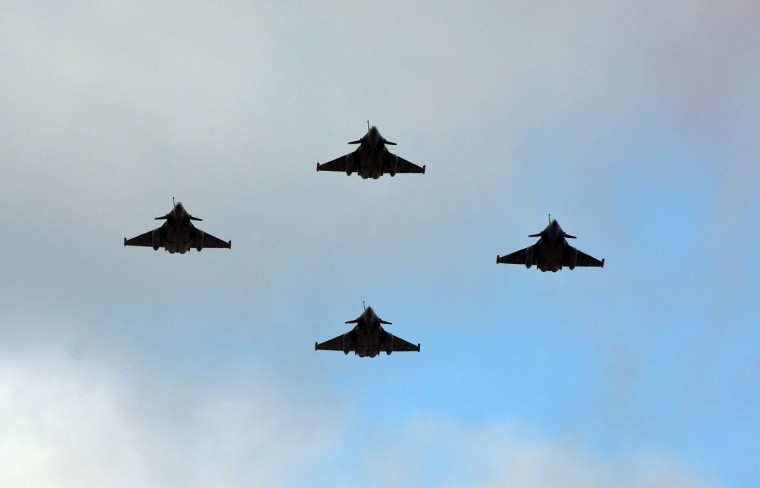 Four French Air Force Rafale C fighter jets fly over the Champs-Elysees avenue during the annual Bastille Day military parade in Paris on July 14, 2015. (ALAIN JOCARD/AFP/Getty Images)