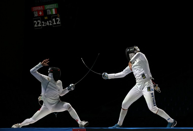 Benjamin Steffen of Switzerland, left, and Enrico Garozzo of Italy, in action during the bronze medal match at men's team epee competition at the fencing World championships in Moscow, Russia, on Saturday, July 18, 2015. Ukraine won the gold, Korea took the silver and Switzerland got the bronze. (Ivan Sekretarev/Associated Press)