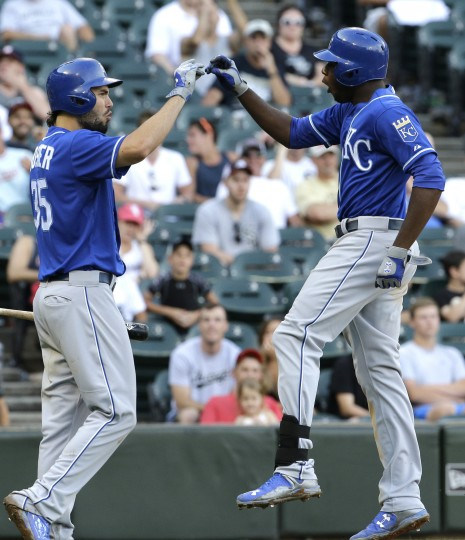 Kansas City Royals' Lorenzo Cain, right, celebrates with teammate Eric Hosmer after hitting a solo home run during the 13th inning of a baseball game against the Chicago White Sox, Saturday, July 18, 2015, in Chicago. The Royals won 7-6. (Nam Y. Huh/Associated Press)