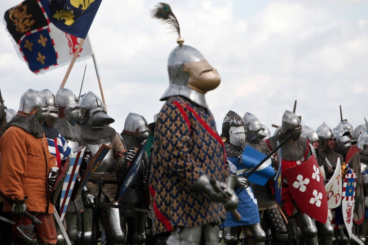 People wear armor as they attend a reenactment of the Battle of Agincourt, in Agincourt, northern France, Saturday, July 25, 2015. The French are hosting a reenactment of the clash with England this weekend. More than 800 people in Medieval garb are gathering at the site to commemorate the battle, which was a turning point in the Hundred Years' War. (Associated Press/Thibault Camus)