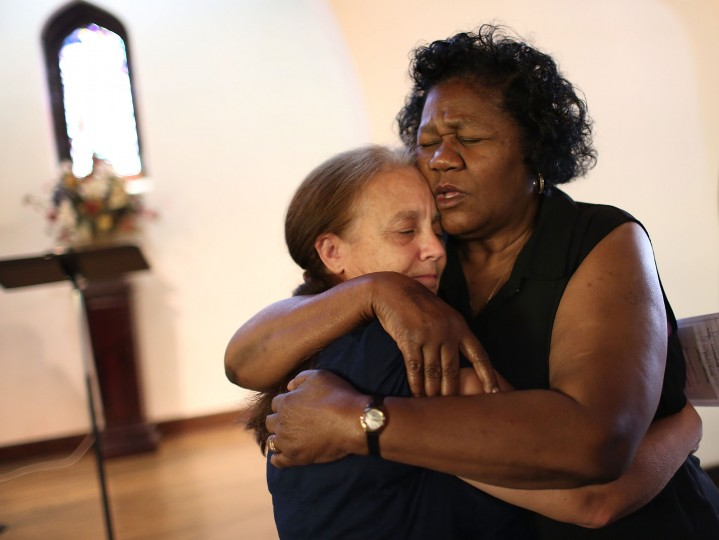 Pam Jorden (L) and Barbara Woods hug during a memorial service at the Chattanooga Church to honor the four Marines and one Navy sailor killed during a shooting on July 18, 2015 in Chattanooga, Tennessee. According to reports, Mohammod Youssuf Abdulazeez, 24, opened fire on the military recruiting station at the strip mall on July 16th and then drove more than seven miles away to an operational support center operated by the U.S. Navy and killed four United States Marines and a Navy sailor. The gunman was likely killed in a exchange of gunfire with the police. (Joe Raedle/Getty Images)