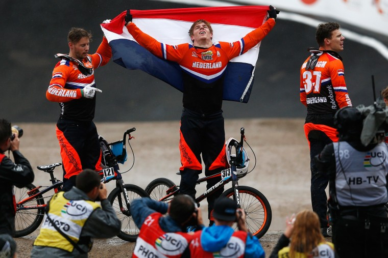 Niek Kimmann of Netherlands celebrates after crossing the finish line first and winning gold in the Men Elite motos during day 5 of the UCI BMX World Championships at on July 25, 2015 in Zolder, Belgium. (Dean Mouhtaropoulos/Getty Images)