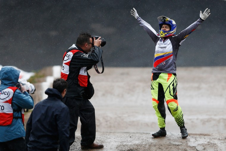 Stefany Hernandez of Venezuela celebrates crossing the finish line first and winning the Gold Medal in the Women Elite motos during day 5 of the UCI BMX World Championships at on July 25, 2015 in Zolder, Belgium. (Dean Mouhtaropoulos/Getty Images)