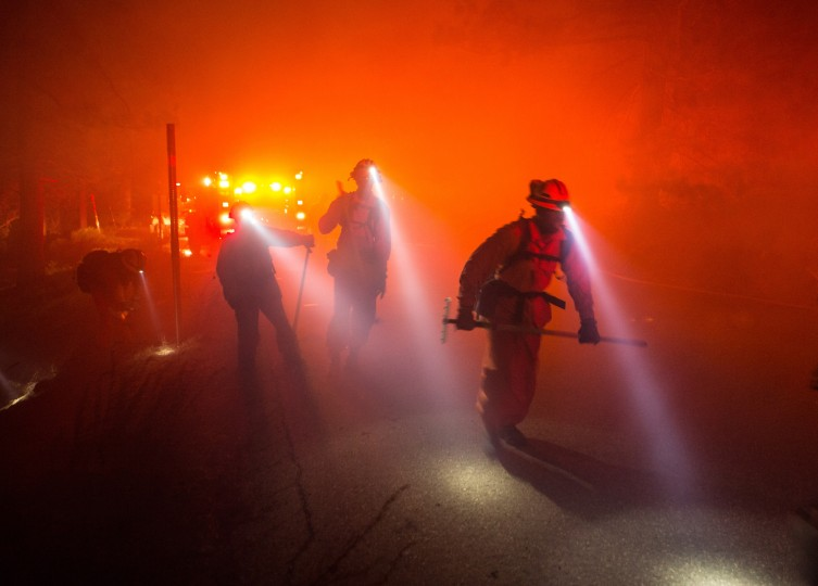 A hand crew prepares to battle The Pine Fire which caused a group of deaf and hearing-impaired children amongst 300 people to evacuated from campgrounds in the San Gabriel Mountains, Calif., near Mountain High Resort late Friday, July 17, 2015. The evacuated campgrounds were the Lion's Camp, Verdugo Campground, AFY Campground and Christian Summer Camp, the Sheriff's department said. About 200 firefighters were on scene. A county fire dispatcher said the fire started on the Los Angeles side of the county line. (Kevin Warn/Associated Press)