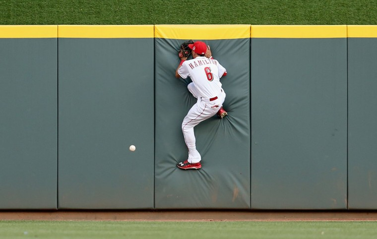 Bily Hamilton #6 of the Cincinnati Reds cannot catch the ball hit by Randal Grichuk of the St. Louis Cardinals that would be a triple in the third inning at Great American Ball Park on August 4, 2015 in Cincinnati, Ohio. (Photo by Andy Lyons/Getty Images)