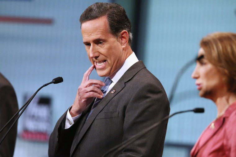 Republican presidential candidate Rick Santorum (C) participates in a presidential pre-debate forum hosted by FOX News and Facebook at the Quicken Loans Arena August 6, 2015 in Cleveland, Ohio. Santorum and six other GOP candidates were selected to participate in the forum based on their rank in an average of the five most recent national political polls. (Photo by Scott Olson/Getty Images)