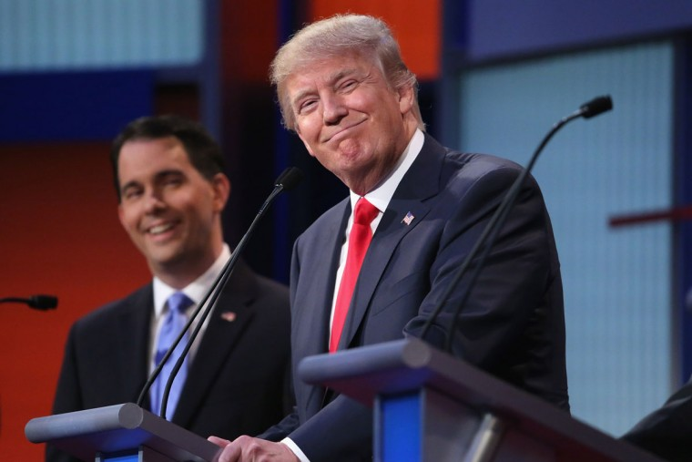 Republican presidential candidates Donald Trump (R) and Wisconsin Gov. Scott Walker participate in the first prime-time presidential debate hosted by FOX News and Facebook at the Quicken Loans Arena August 6, 2015 in Cleveland, Ohio. The top-ten GOP candidates were selected to participate in the debate based on their rank in an average of the five most recent national political polls. (Photo by Chip Somodevilla/Getty Images)