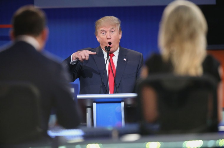 Republican presidential candidate Donald Trump fields a question during the first Republican presidential debate hosted by Fox News and Facebook at the Quicken Loans Arena on August 6, 2015 in Cleveland, Ohio. The top ten GOP candidates were selected to participate in the debate based on their rank in an average of the five most recent political polls. (Photo by Scott Olson/Getty Images)