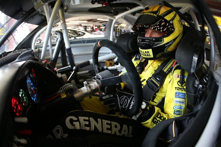 Matt Kenseth, driver of the #20 Dollar General Toyota, sits in his car during practice for the NASCAR Sprint Cup Series Cheez-It 355 at Watkins Glen International on August 7, 2015 in Watkins Glen, New York. (Chris Graythen/Getty Images)