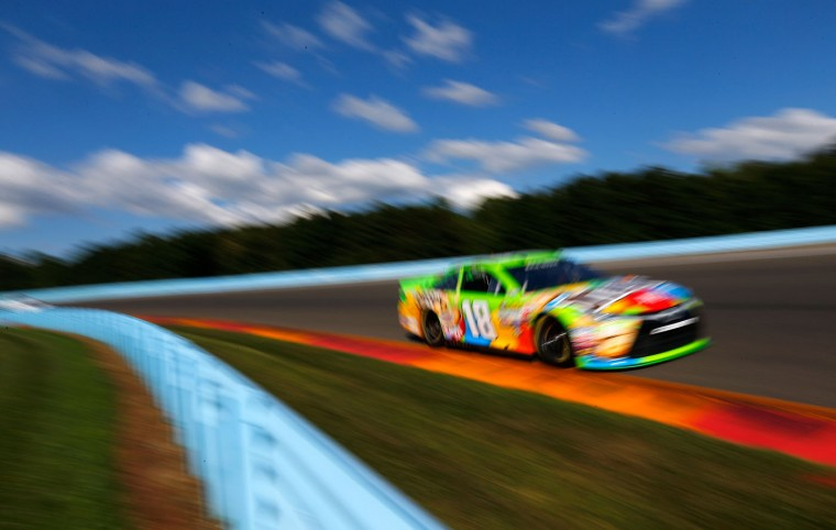 Kyle Busch, driver of the #18 M&M Crispy Toyota, practices for the NASCAR Sprint Cup Series Cheez-It 355 at Watkins Glen International on August 7, 2015 in Watkins Glen, New York. (Jonathan Ferrey/Getty Images)