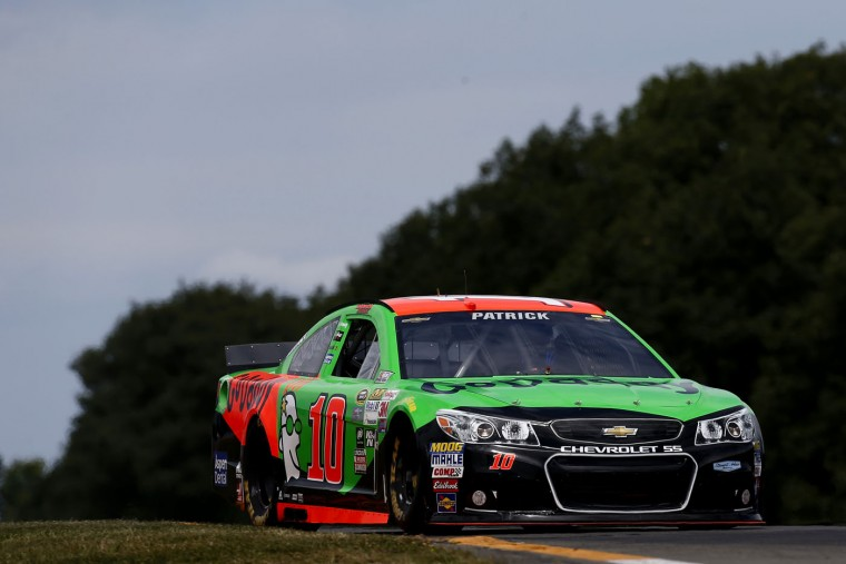 Danica Patrick, driver of the #10 GoDaddy Chevrolet, races during qualifying for the NASCAR Sprint Cup Series Cheez-It 355 at Watkins Glen International on August 8, 2015 in Watkins Glen, New York. (Jeff Zelevansky/Getty Images)