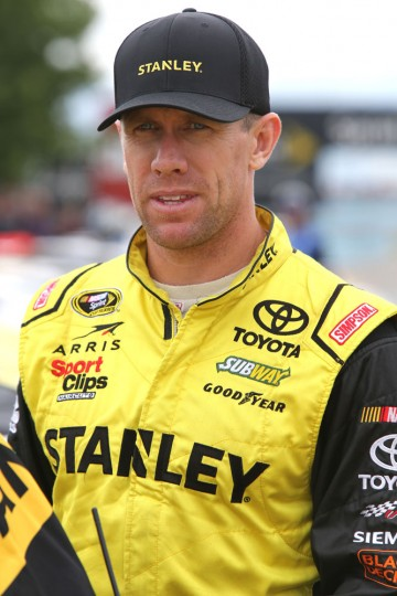 Carl Edwards, driver of the #19 Stanley Toyota, stands on the grid during qualifying for the NASCAR Sprint Cup Series Cheez-It 355 at Watkins Glen International on August 8, 2015 in Watkins Glen, New York. (Jerry Markland/Getty Images)