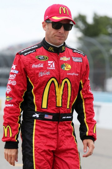 Jamie McMurray, driver of the #1 McDonald's Chevrolet, stands on the grid during qualifying for the NASCAR Sprint Cup Series Cheez-It 355 at Watkins Glen International on August 8, 2015 in Watkins Glen, New York. (Jerry Markland/Getty Images)