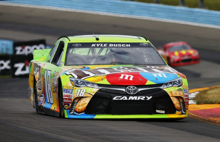 Kyle Busch, driver of the #18 M&M Crispy Toyota, races during qualifying for the NASCAR Sprint Cup Series Cheez-It 355 at Watkins Glen International on August 8, 2015 in Watkins Glen, New York. (Photo by Jonathan Ferrey/Getty Images)