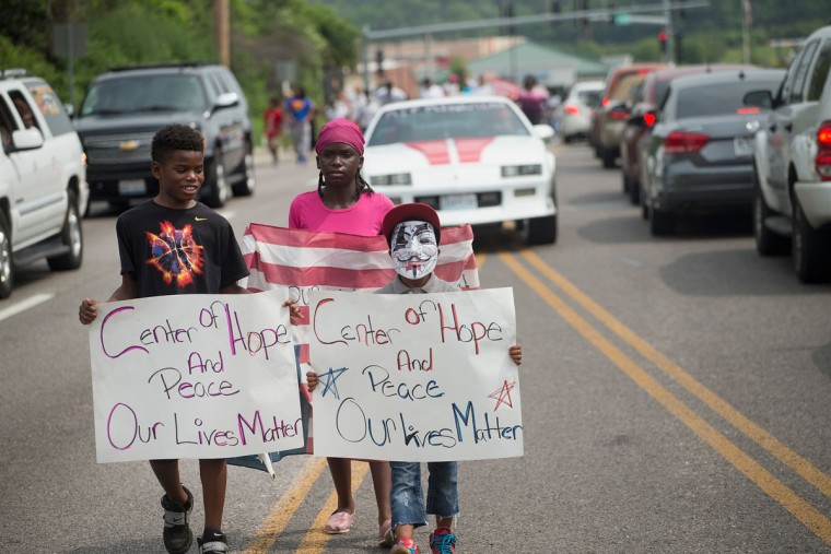 Young demonstrators march from the location where Michael Brown was shot and killed in Ferguson, Missouri to Normandy High School where he was a student to mark the first anniversary of his death on August 8, 2015 in Jennings, Missouri. Brown was shot and killed by a Ferguson police officer on August 9, 2014. His death sparked months of sometimes violent protests in Ferguson and drew nationwide focus on police treatment of black offenders. (Photo by Scott Olson/Getty Images)