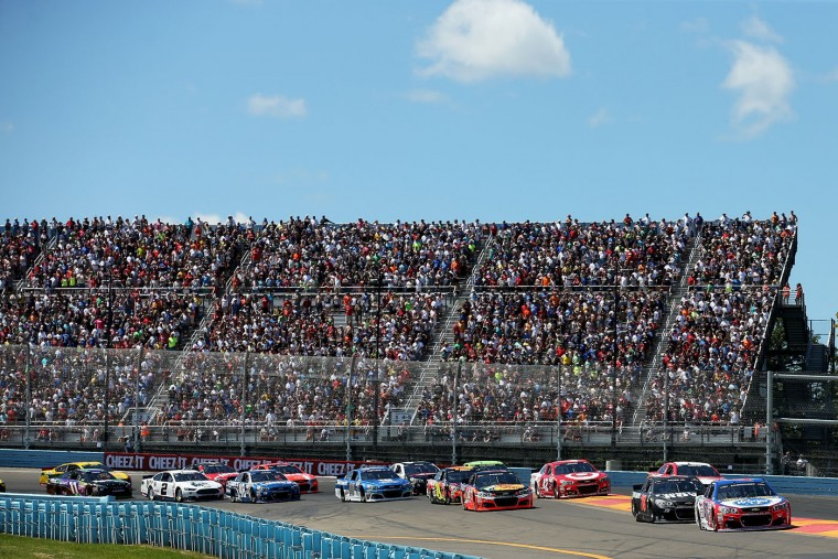 AJ Allmendinger, driver of the #47 Kroger/Bush's Beans Chevrolet, leads the field at the start of the NASCAR Sprint Cup Series Cheez-It 355 at the Glen at Watkins Glen International on August 9, 2015 in Watkins Glen, New York. (Chris Graythen/Getty Images)