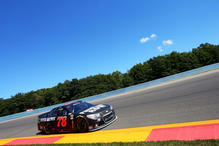 Martin Truex Jr., driver of the #78 Furniture Row/Visser Precision Chevrolet, races during the NASCAR Sprint Cup Series Cheez-It 355 at the Glen at Watkins Glen International on August 9, 2015 in Watkins Glen, New York. (Matt Sullivan/Getty Images)