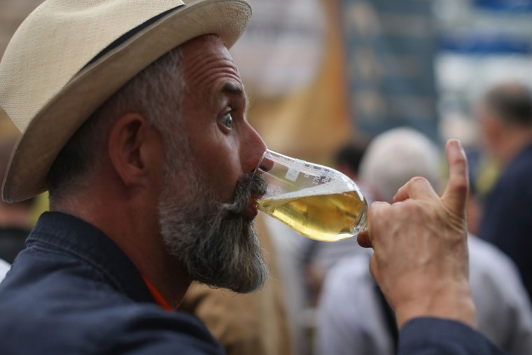 A man drinks a glass of Ale at the CAMRA (campaign for real ale) Great British Beer festival at Olympia London exhibition centre on August 12, 2015 in London, England. The five day event is Britain's largest beer festival with around 55,000 people expected to attend. The festival features over 900 British real ales, ciders and perries from around the world on sale. (Photo by Dan Kitwood/Getty Images)