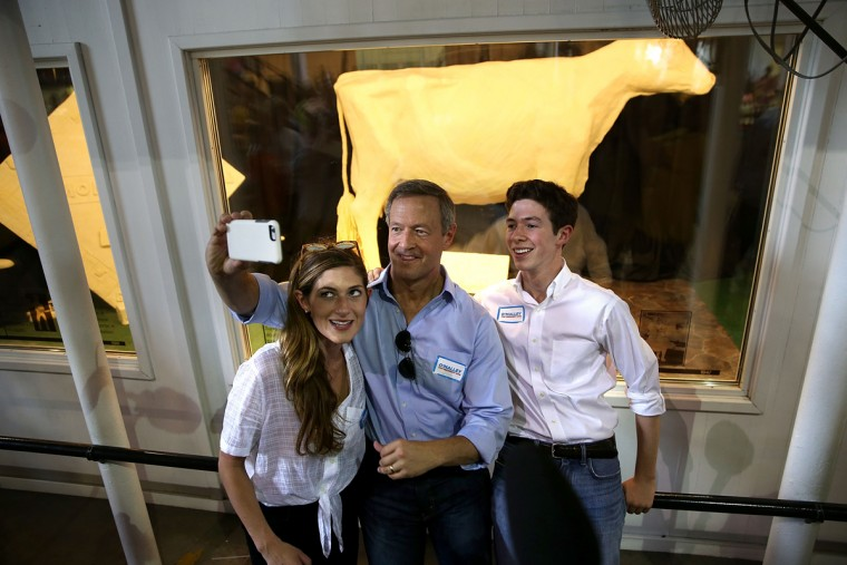 DES MOINES, IA - AUGUST 13: Democratic presidential hopeful and former Maryland Gov. Martin O'Malley (C) takes a selfie in front of the Butter Cow with his children Grace (L) and William (R) during the Iowa State Fair on August 13, 2015 in Des Moines, Iowa. Presidential candidates are addressing attendees at the Iowa State Fair on the Des Moines Register Soapbox stage. The State Fair runs through August 23. (Photo by Justin Sullivan/Getty Images)