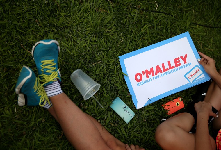 DES MOINES, IA - AUGUST 13: A supporter of democratic presidential hopeful and former Maryland Gov. Martin O'Malley holds a campaign sign as he speaks to fairgoers during the Iowa State Fair on August 13, 2015 in Des Moines, Iowa. Presidential candidates are addressing attendees at the Iowa State Fair on the Des Moines Register Presidential Soapbox stage. The State Fair runs through August 23. (Photo by Justin Sullivan/Getty Images)
