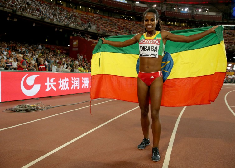 Genzebe Dibaba of Ethiopia celebrates after winning gold in the Women's 1500 meters final during day four of the 15th IAAF World Athletics Championships Beijing 2015 at Beijing National Stadium on August 25, 2015 in Beijing, China. (Photo by Andy Lyons/Getty Images)
