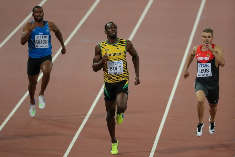 Rolando Palacios of Honduras, Usain Bolt of Jamaica and Julian Reus of Germany compete in the Men's 200 meters heats during day four of the 15th IAAF World Athletics Championships Beijing 2015 at Beijing National Stadium on August 25, 2015 in Beijing, China. (Photo by Lintao Zhang/Getty Images for IAAF)