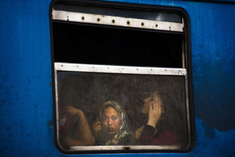 A migrant looks out the window of a train heading to the border with Serbia at the train station in Gevgelija on the Macedonian-Greek border on August 4, 2015. Many migrants try to cross Macedonia and Serbia to enter the European Union via Hungary, a country that will finish building its anti-migrant fence on its southern border with Serbia by August 31, ahead of a previous November deadline. (AFP Photo/Dimitar Dilkoff)