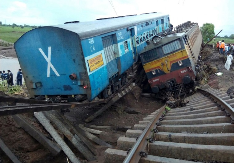 Two Indian passenger trains lay next to each other following a derailment after they were hit by flash floods on a bridge outside the town of Harda in Madhya Pradesh state on August 5, 2015. Two passenger trains derailed after being hit by flash floods on a bridge in central India, killing at least 27 people in the latest deadly accident on the nation's crumbling rail network. (AFP Photo/P /afp/getty )