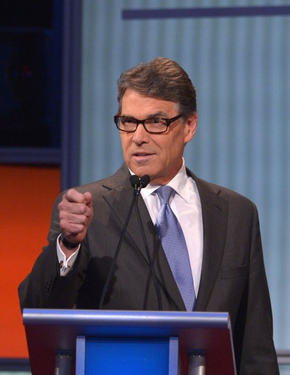 Republican presidential hopeful Rick Perry speaks during the Republican presidential primary debate on August 6, 2015 at the Quicken Loans Arena in Cleveland, Ohio. Seven candidates are debating before the top 10 candidates face off during prime time. (AFP Photo/P /mandel )