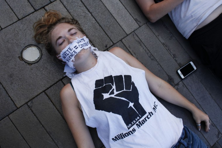 Demonstrators take part on a die-in during a Michael Brown memorial protest in Brooklyn, New York on August 9, 2015. Demonstrators showed support Sunday on the one year anniversary of 18-year-old Michael Brown, an unarmed black teen who was shot and killed in Ferguson, Missouri by a white police officer, Darren Wilson, throwing America's troubled race relations into harsh relief. (Kena Betancur/AFP/Getty Images)