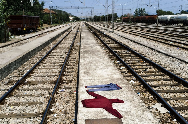 Laundered migrant's clothes dry on a platform at the train station in Gevgelija, on the Macedonian-Greek border. The EU announced August 11 that it has approved 2.4 billion euros ($2.6 billion) of funding to help member states over the next few years cope with the flood of migrants entering the bloc. (AFP Photo/Dimitar Dilkoff)