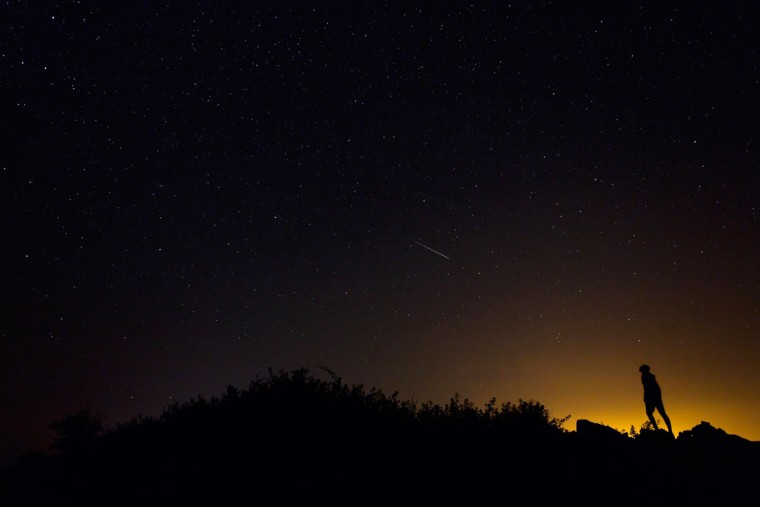 "A Perseid meteor along the Milky Way illuminates the dark sky near Villadiego in the province of Burgos, northern Spain, during the ""Perseids"" meteor shower on August 12, 2015. (AFP Photo/P / )"