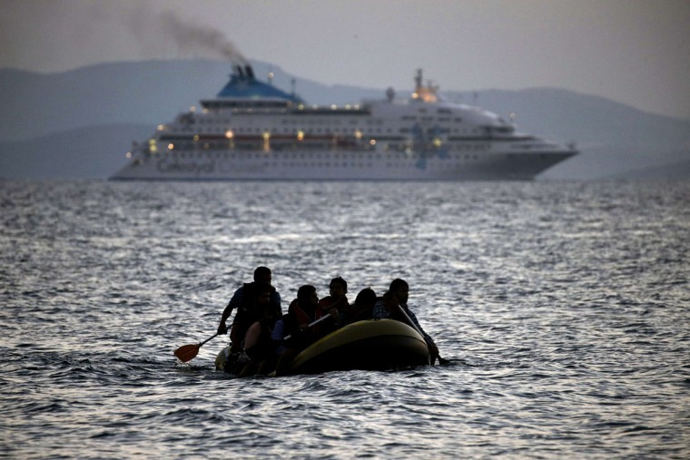 Migrants arrive on the shore of Kos island on a small dinghy on August 19, 2015. Authorities on the island of Kos have been so overwhelmed that the government sent a ferry to serve as a temporary centre to issue travel documents to Syrian refugees -- among some 7,000 migrants stranded on the island of about 30,000 people. The UN refugee agency said in the last week alone, 20,843 migrants -- virtually all of them fleeing war and persecution in Syria, Afghanistan and Iraq -- arrived in Greece, which has seen around 160,000 migrants land on its shores since January, according to the UN refugee agency. (AFP Photo/Angelos Tzortzinis)