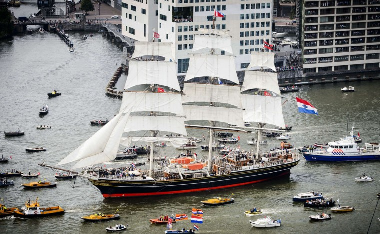 An aerial picture taken on August 19, 2015 of the Clipper stad Amsterdam accompanied by smaller boats, on their way to Amsterdam to join the parade of ships during the five-yearly event Sail. (ROBIN VAN LONKHUIJSEN/AFP/Getty Images)
