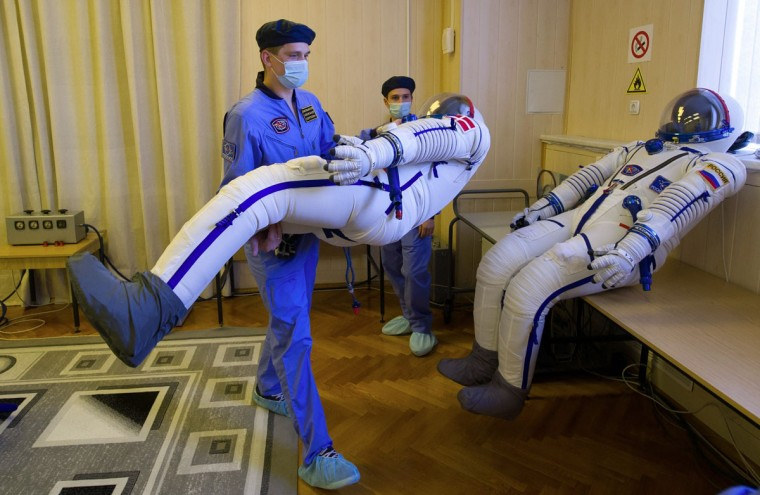 Employees prepare spacesuits at the Russian-leased Baikonur cosmodrome in Kazakhstan on August 19, 2015. Members of the main crew of the 45/46 expedition to the International Space Station, Kazakhstan's cosmonaut Aydyn Aimbetov, Russian cosmonaut Sergei Volkov and Denmark's astronaut Andreas Mogensen from the European Space Agency are scheduled to blast off to the ISS on September 2, 2015. (AFP Photo/Stringer)