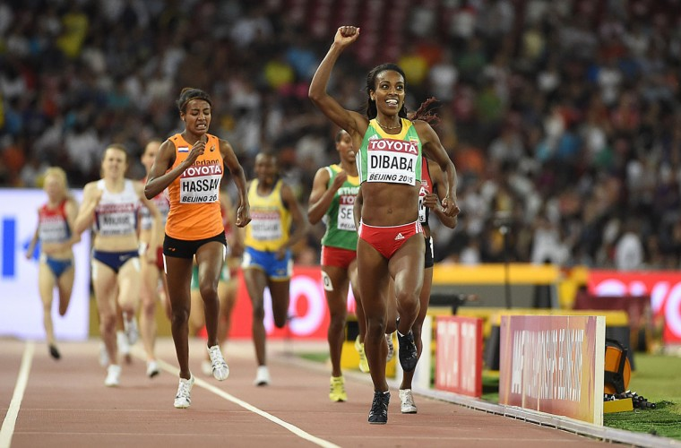 "Ethiopia's Genzebe Dibaba celebrates winning the final of the women's 1500 meters athletics event at the 2015 IAAF World Championships at the ""Bird's Nest"" National Stadium in Beijing on August 25, 2015. (OLIVIER MORIN/AFP/Getty Images)"