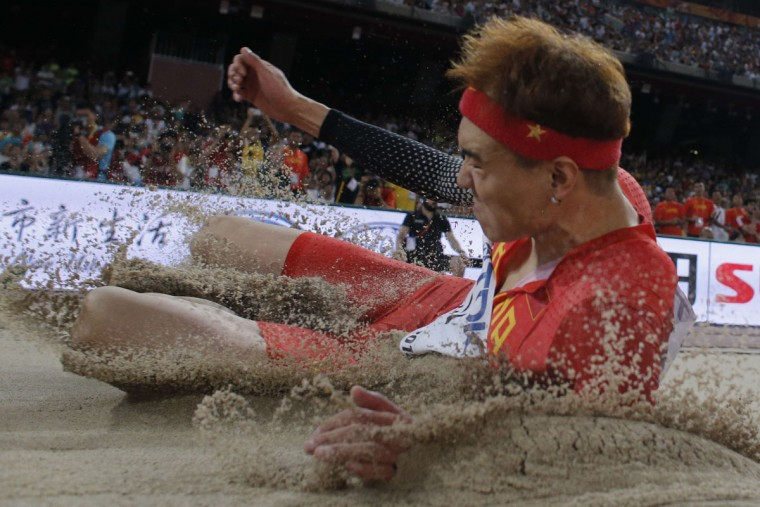 "China's Li Jinzhe competes in the final of the men's long jump athletics event at the 2015 IAAF World Championships at the ""Bird's Nest"" National Stadium in Beijing on August 25, 2015. (ADRIAN DENNIS/AFP/Getty Images)"