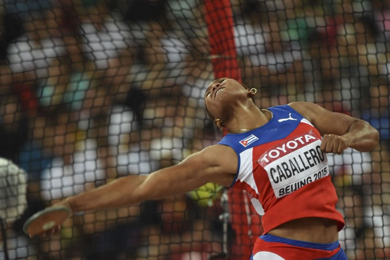 "Cuba's Denia Caballero competes in the final of the women's discus throw athletics event at the 2015 IAAF World Championships at the ""Bird's Nest"" National Stadium in Beijing on August 25, 2015. (FRANCK FIFE/AFP/Getty Images)"