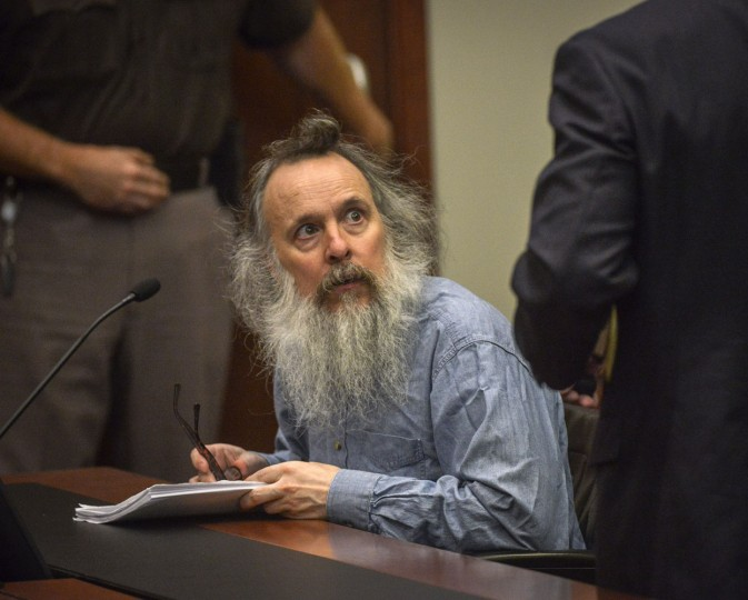 Charles Severance, center, listens to his attorney during a pretrial hearing for his upcoming murder trial, Thursday, Aug., 13, 2015, in Fairfax, Va. Lawyers for Severance, charged with killing three Alexandria residents over a 10-year span, said Thursday their client is innocent and that his mental illness and paranoia made him the target of unfounded suspicions. At the pretrial hearing, lawyers for Severance won the right to tell jurors about Severance's mental illness at his upcoming trial. (Bill O'Leary/The Washington Post via AP, Pool)