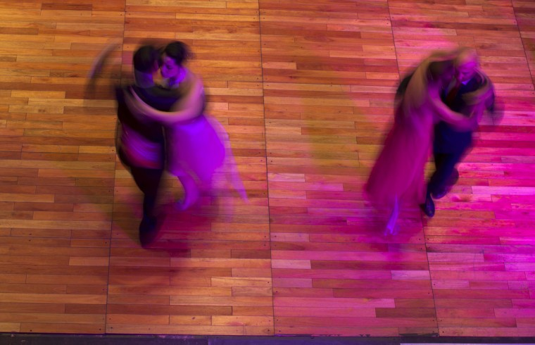 Couples compete in the salon category at the World Tango Championship first round, in Buenos Aires, Argentina, Tuesday, Aug. 18, 2015. More than seven hundred couples from 43 countries around the world are competing in the championship's two categories: salon, and stage. (AP Photo/Natacha Pisarenko)