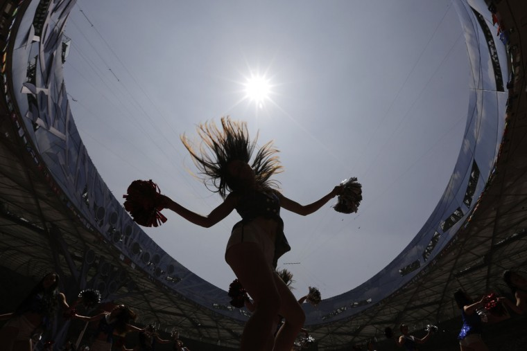 Cheerleaders are silhouetted as they rehearse on the track at the Bird's Nest Stadium in preparation for the upcoming World Athletics Championships in Beijing Thursday, Aug. 20, 2015. (AP Photo/Andy Wong)