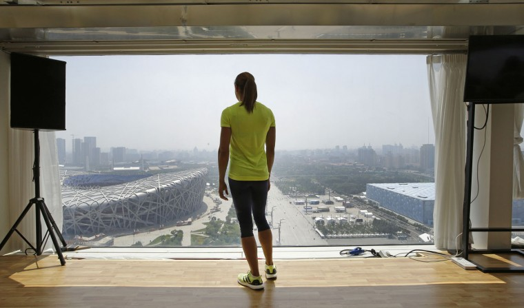 Britain's Jessica Ennis-Hill looks down at the Bird's Nest stadium in Beijing during a press briefing Thursday Aug. 20, 2015. Final preparations are being made for the World Athletics Championships which get underway on Saturday Aug. 22. (AP Photo/Lee Jin-man)