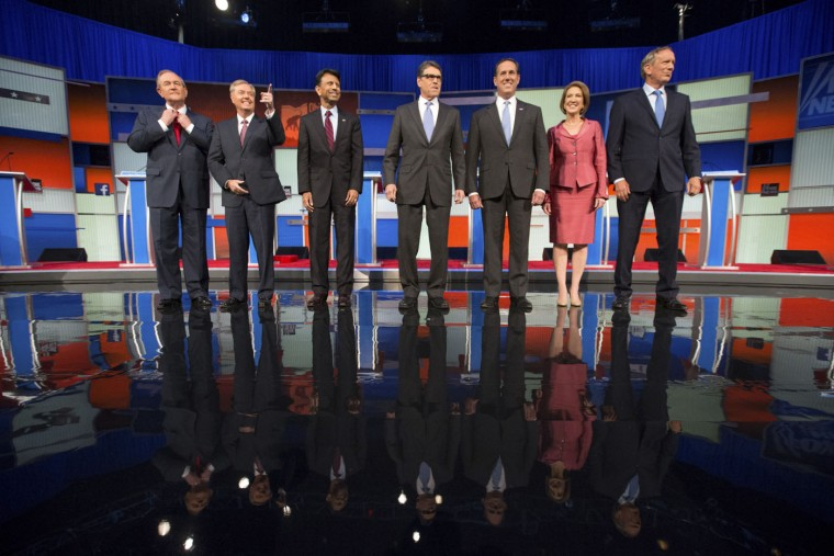 Republican presidential candidates from left, Jim Gilmore, Lindsey Graham, Bobby Jindal, Rick Perry, Rick Santorum, Carly Fiorina, and George Pataki take the stage for a pre-debate forum at the Quicken Loans Arena, Thursday, Aug. 6, 2015, in Cleveland. Seven of the candidates have not qualified for the primetime debate. (AP Photo/Andrew Harnik)