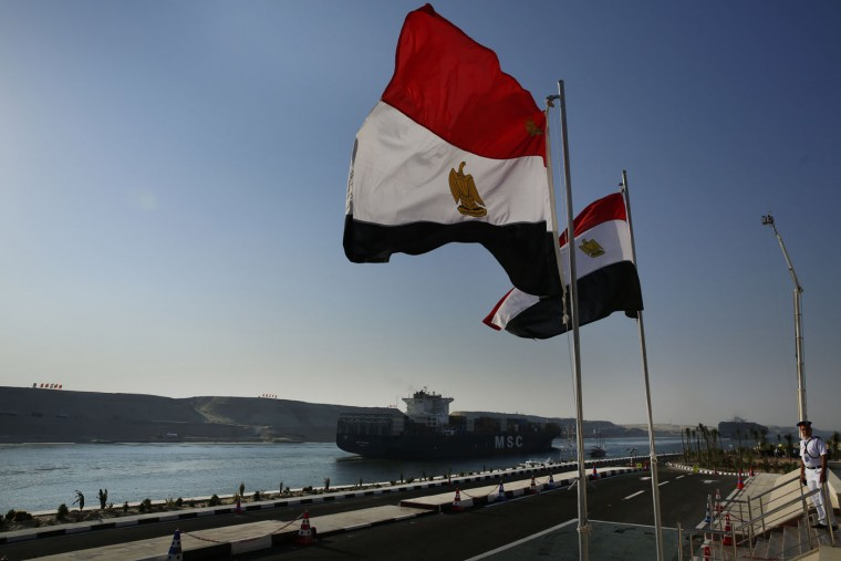 A cargo container ship crosses the new section of the Suez Canal after the opening ceremony in Ismailia, Egypt, Thursday, Aug. 6, 2015. With much pomp and fanfare, Egypt on Thursday unveiled a major extension of the Suez Canal whose patron, President Abdel-Fattah el-Sissi, has billed as an historic achievement needed to boost the country's ailing economy after years of unrest. (AP Photo/Hassan Ammar)