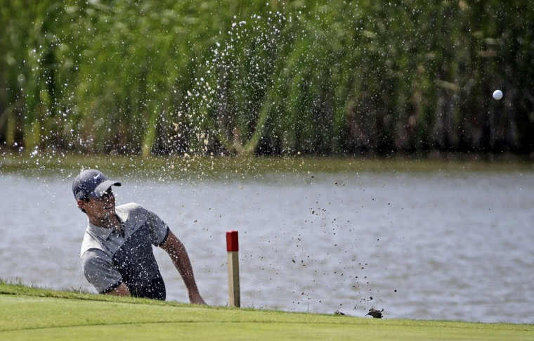 Rory McIlroy, of Northern Ireland, hits out of some water on the fifth hole during the first round of the PGA Championship golf tournament Thursday, Aug. 13, 2015, at Whistling Straits in Haven, Wis. (AP Photo/Brynn Anderson)