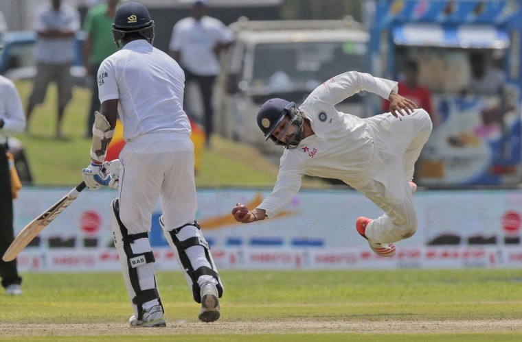 India's Rohit Sharma successfully completes a catch to dismiss Sri Lanka's Angelo Mathews during the first cricket test match between India and Sri Lanka in Galle, Sri Lanka, Wednesday, Aug. 12, 2015. (AP Photo/Eranga Jayawardena)